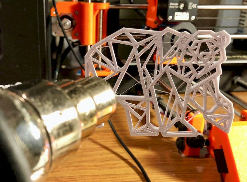 Removing 3D print stringies with a heat gun all at once