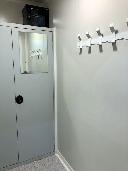 A locker room for changing in the AddUp modular 3D metal printing system
