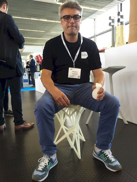 BigRep CEO Rene Gurka testing some 3D printed furniture