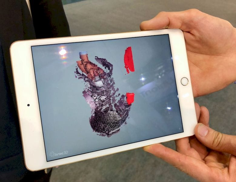 A secondary screen on a nearby tablet shows current activity on the Artec Leo 3D scanner