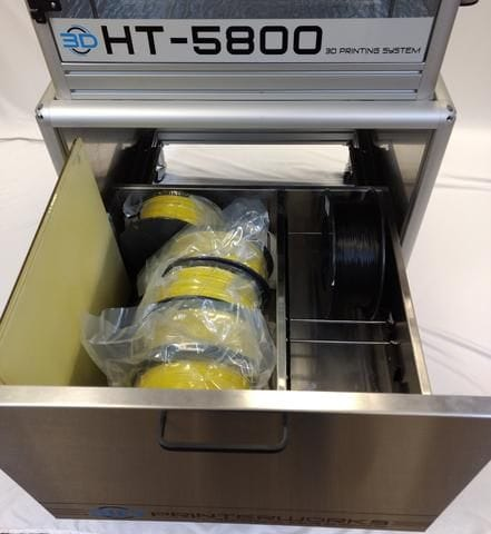 Storing materials in the HT 5800's cabinet bay