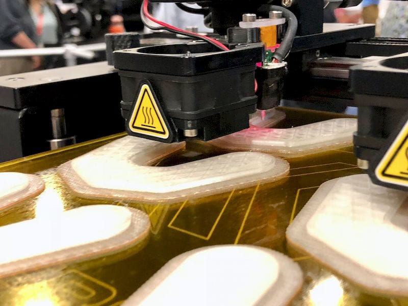 The MakerGear M3 Rev 1 3D printing on a very level surface