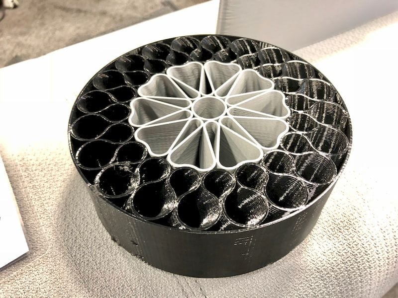 A 3D printed wheel and tire by BigRep. The black portion is flexible