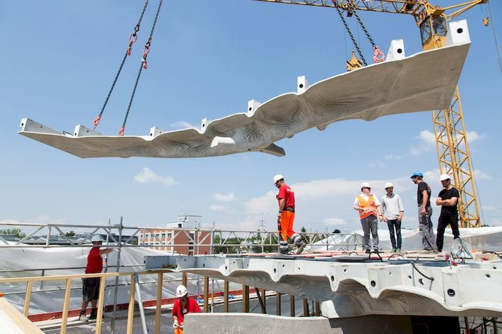 Lifting one of the Smart Slabs into position [Source: Dezeen]