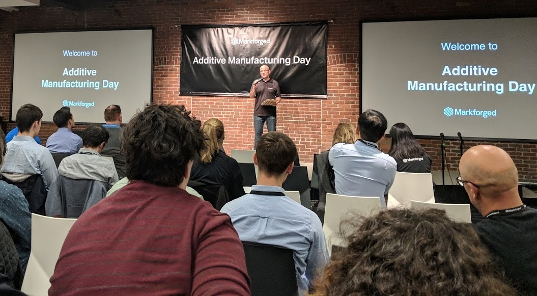Markforged CMO Bryan Semple welcoming on-site and virtual attendees to Additive Manufacturing Day [Image: Fabbaloo]