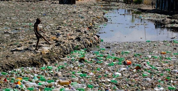 A waste dump in Haiti where recyclable plastic bottles may be obtained [Source: Clean Currents]