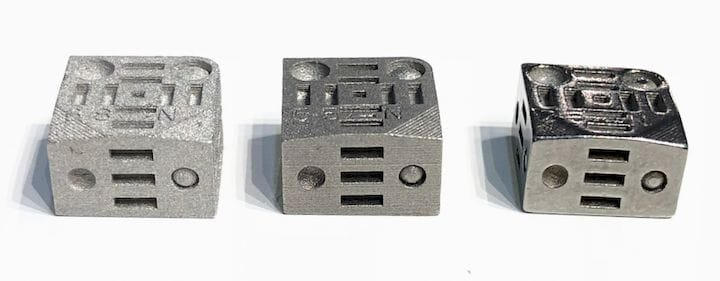 Three small 3D printed metal parts made by Digital Metal. On left, unfinished from the printer; with two examples of post-print finishing to smooth surfaces [Source: Fabbaloo]