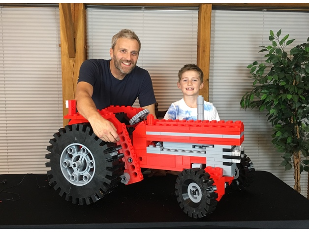 Matt Denton, his nephew Ruben, and their giant 3D printed LEGO tractor [Image: Matt Denton via Thingiverse]
