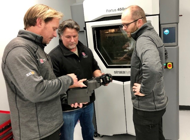 The team at Andretti leverage the Stratasys Fortus 450mc 3D Printer to speed design and development. Pictured from the team (L-R): Eric Bretzman, Technical Director; Michael Andretti, CEO; Aaron Marney, Senior Development Engineer [Image: Stratasys]
