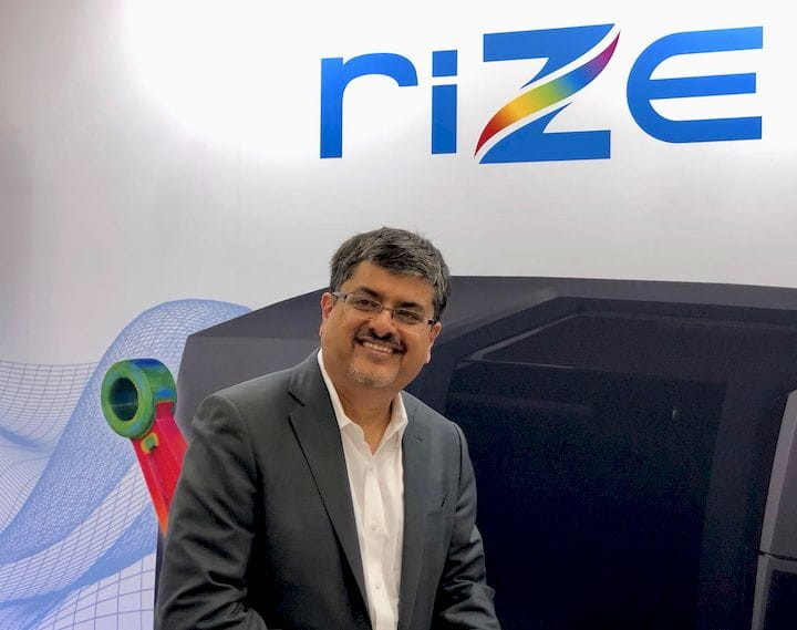 Rize CEO Andy Kalambi beside their XRIZE 3D printer [Source: Fabbaloo]