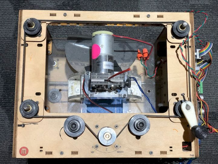 The ancient MakerBot CupCake, showing a very dumb four-screw driven platform [Source: Fabbaloo]