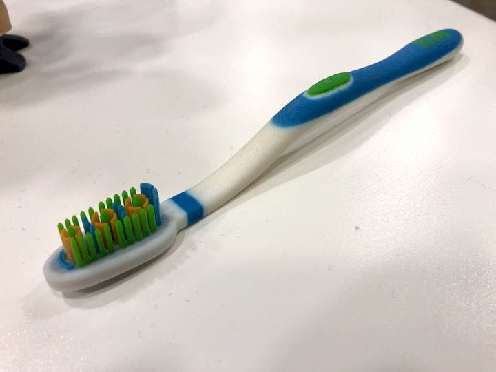 A color 3D printed toothbrush, made on a Stratasys J750. The bristles are rigid, not soft, though the J750 can print with flexible materials [Source: Fabbaloo]