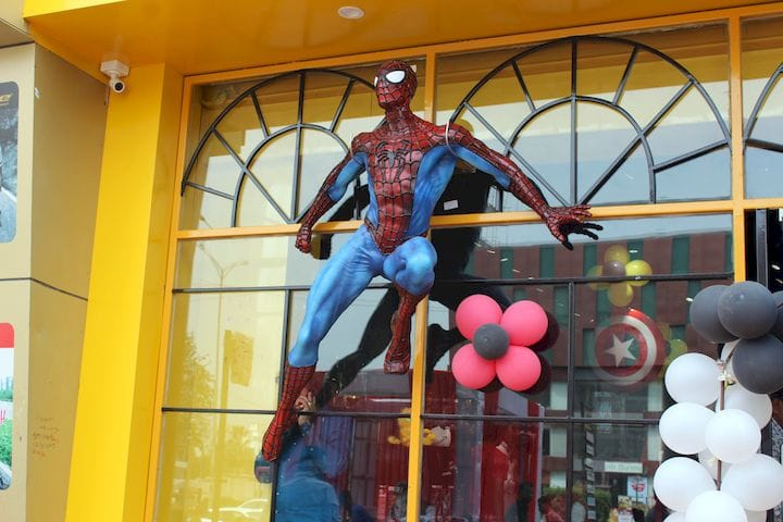 The 3D printed Spiderman sculpture mounted on a storefront [Source: STPL 3D Printing]