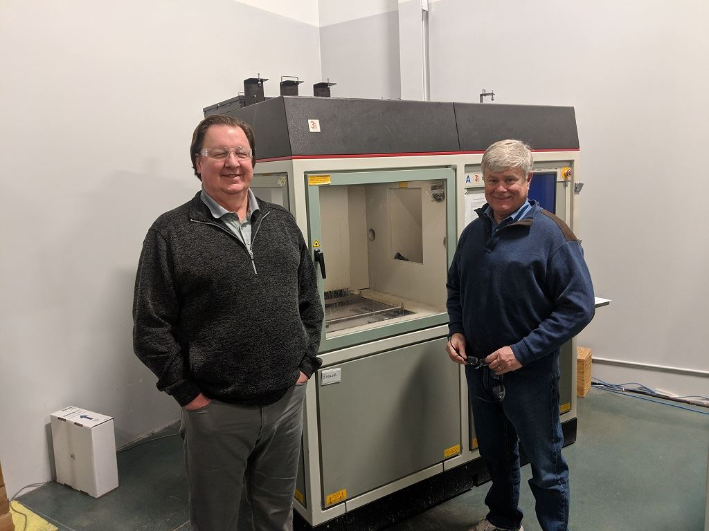 Mark and Chip with The Technology House's first SLA 3D printer [Image: Sarah Goehrke]