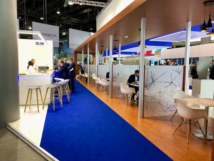A typical large vendor stand at Formnext; note the separate areas for product purchase negotiations [Source: Fabbaloo]