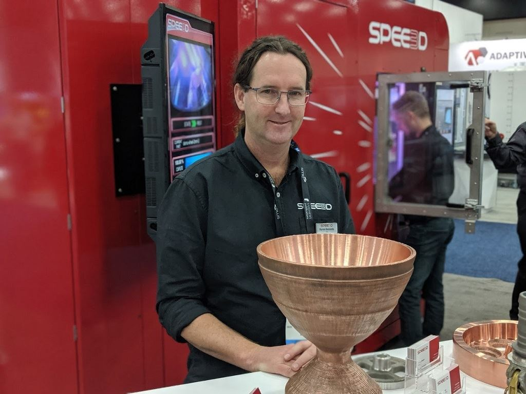 SPEE3D CEO Byron Kennedy with a 20kg copper rocket part [Image: Fabbaloo]