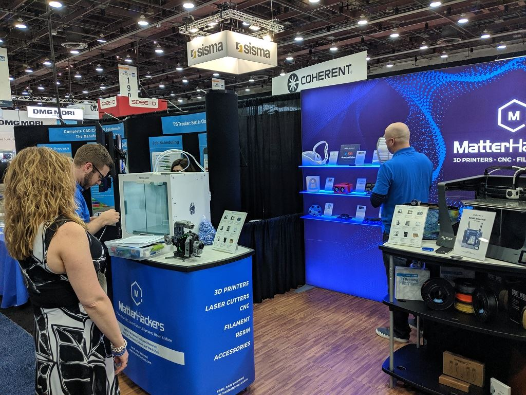 Mara and the MatterHackers team finalize setup just before the exhibit floor opened for RAPID + TCT 2019 [Image: Fabbaloo]
