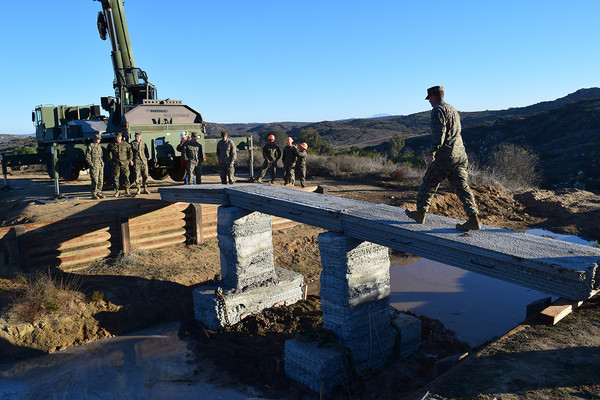 3D printed concrete footbridge created by United States Marines [Source:  Defense Logistics Agency ]