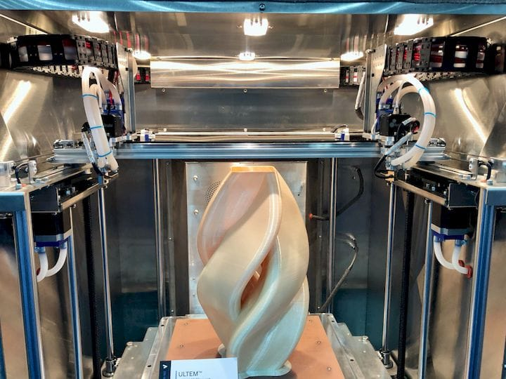 Inside the AON-M2 high-temp 3D printer with an ULTEM print on the bed [Source: Fabbaloo]