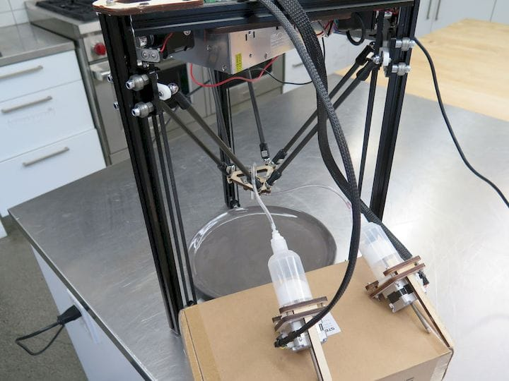 A delta 3D printer modified to use a coaxial nozzle [Source: 3D Digital Cooks]
