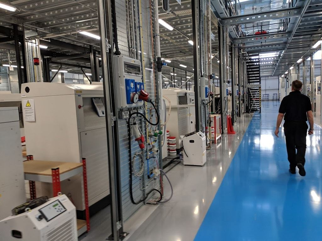 Phil Hatherley, General Manager, Materials Solutions,  leads the way through the 3D printing floor at the Materials Solutions facility  in the UK [Image: Sarah Goehrke/Fabbaloo]