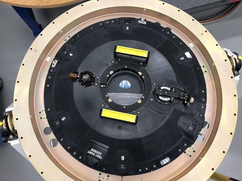 Image of NASA's Orion spacecraft — docking hatch. 3D printed in six separate interlocking parts on Stratasys machines. PEKK-based materials. [Image: Stratasys]