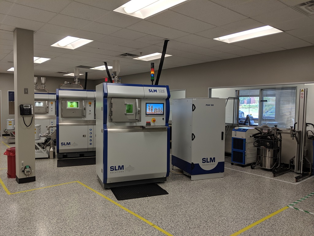 SLM Solutions machines and powder sieving stations set up in Wixom, MI [Image: Fabbaloo]