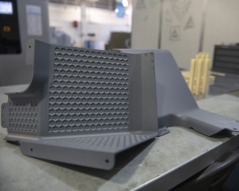 Latrine covers, the first aircraft parts authorized for use after being printed on the Stratasys F900 3D printer are on display Aug. 15, 2019, at Travis Air Force Base, Calif. [Image: U.S. Air Force photo by Louis Briscese]