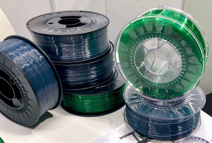Spools of translucent green and blue-gray PET filament from RE PET 3D [Source: Fabbaloo]