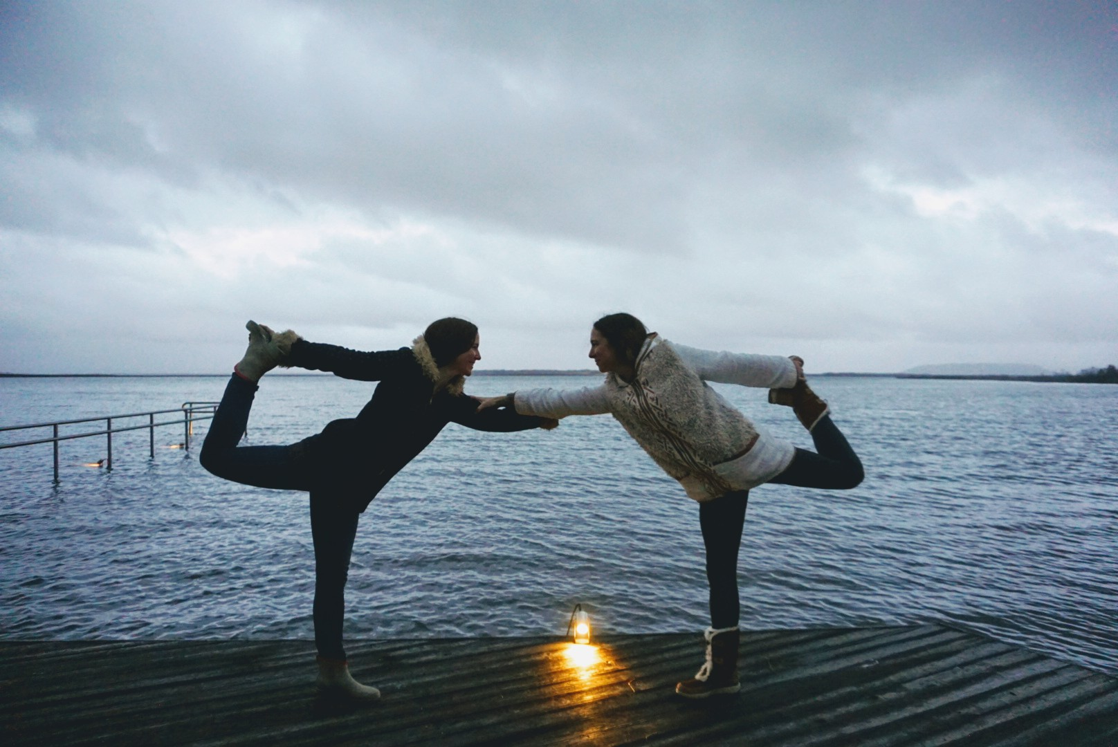 Yoga on the deck of the lake.
