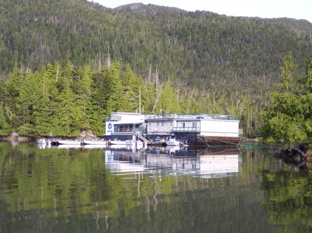 There is the lodge, atop a floating barge, anchored in a protective cove.