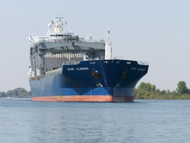 Large ocean going ship heading up the San Joaquin River to the Port of Stockton.