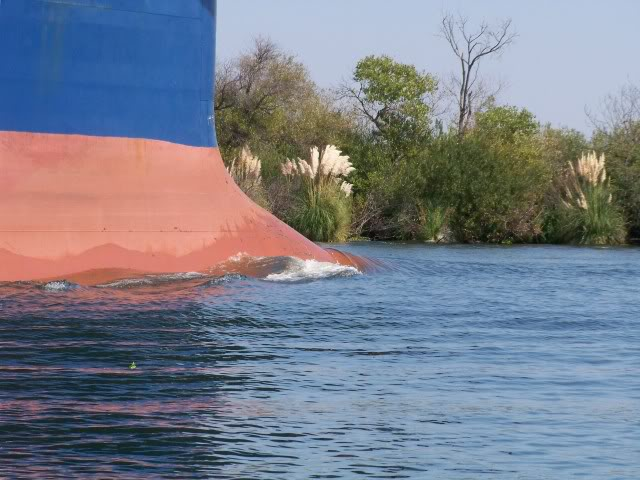If this is your first encounter with a large ship in the rivers do not let this one and it's lack of a wake fool you. Most wakes from ships this size can be deadly.