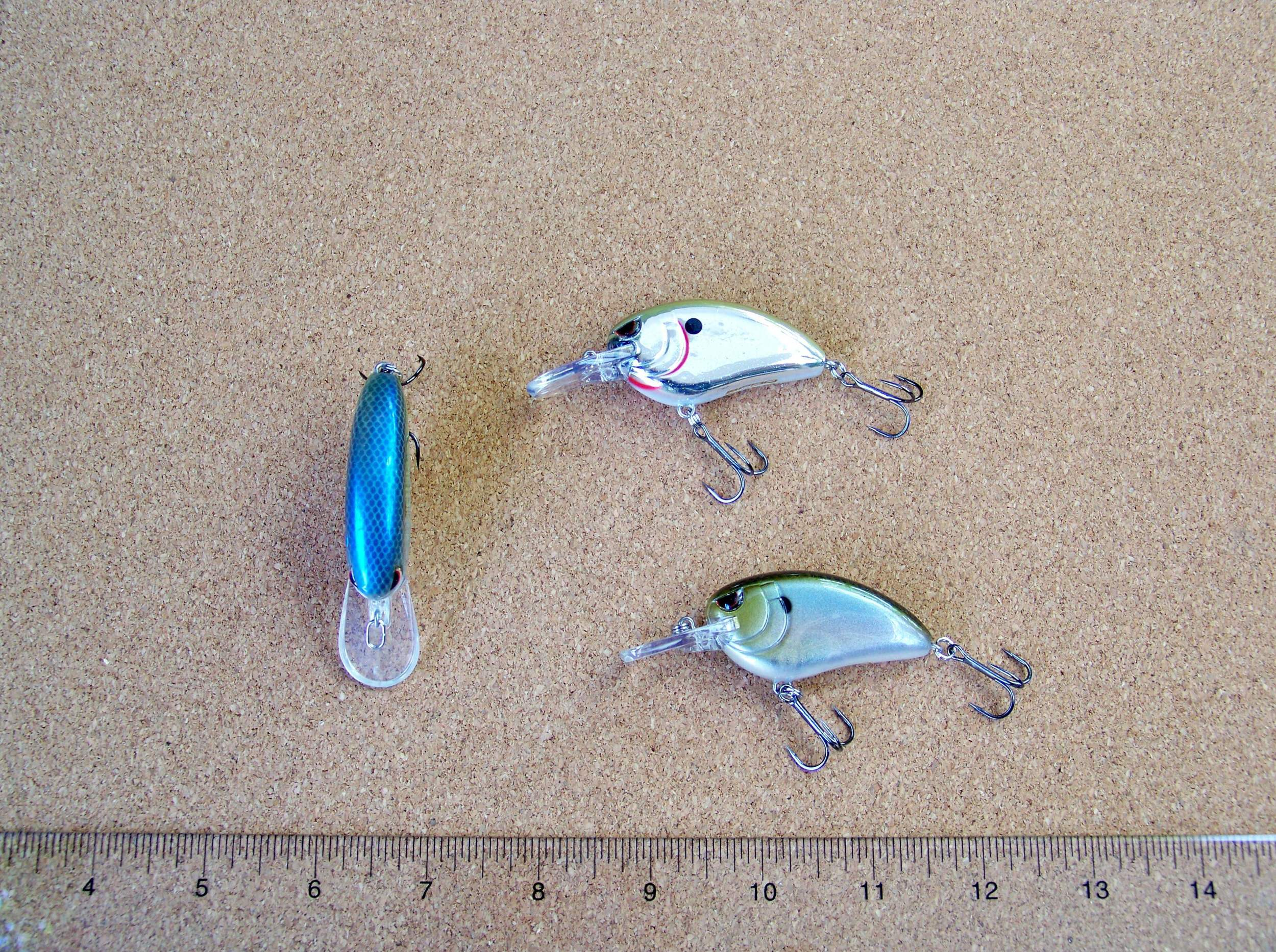 Little John MD 50 runs to 9 feet, left - Spooky Nasty / top right - Chrome Olive / bottom right - Spooky Shad, Crews will present this crank when he finds lay downs and brush located next to a drop off location with the top of the brush in the 7 foot deep range. The bait comes through brush well, allows you to deflect and with its slow rising float provides an effective pause in the strike zone!