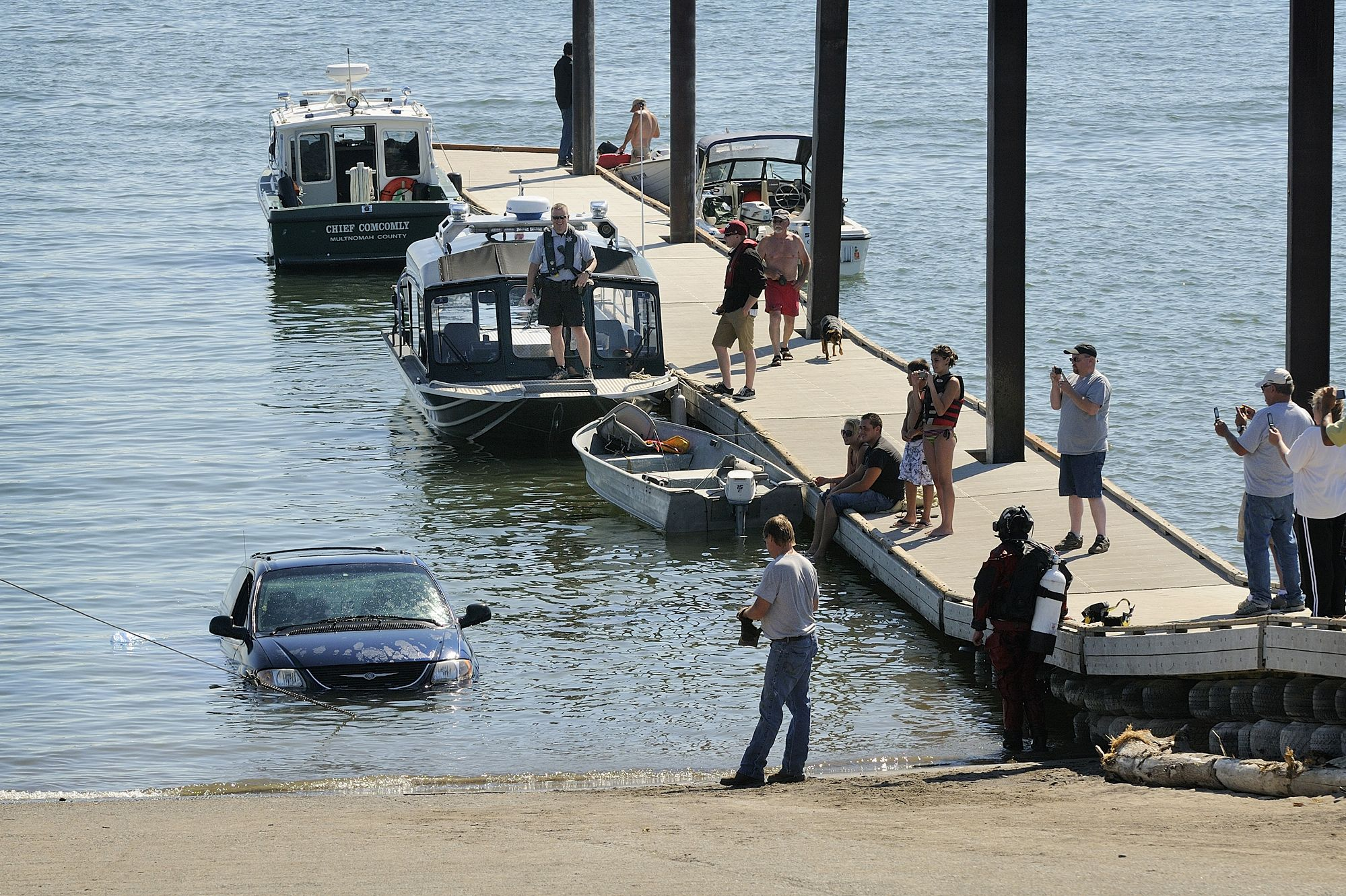 Robert Sharp's minivan is pulled from the Columbia River at the Marine Park boat launch Tuesday after his wife, Teresa, backed too far down the ramp while putting their boat in the water. No one was reported injured. (   TroyWayrynen   /TheColumbian). Be careful what you wish for Mike Jones!
