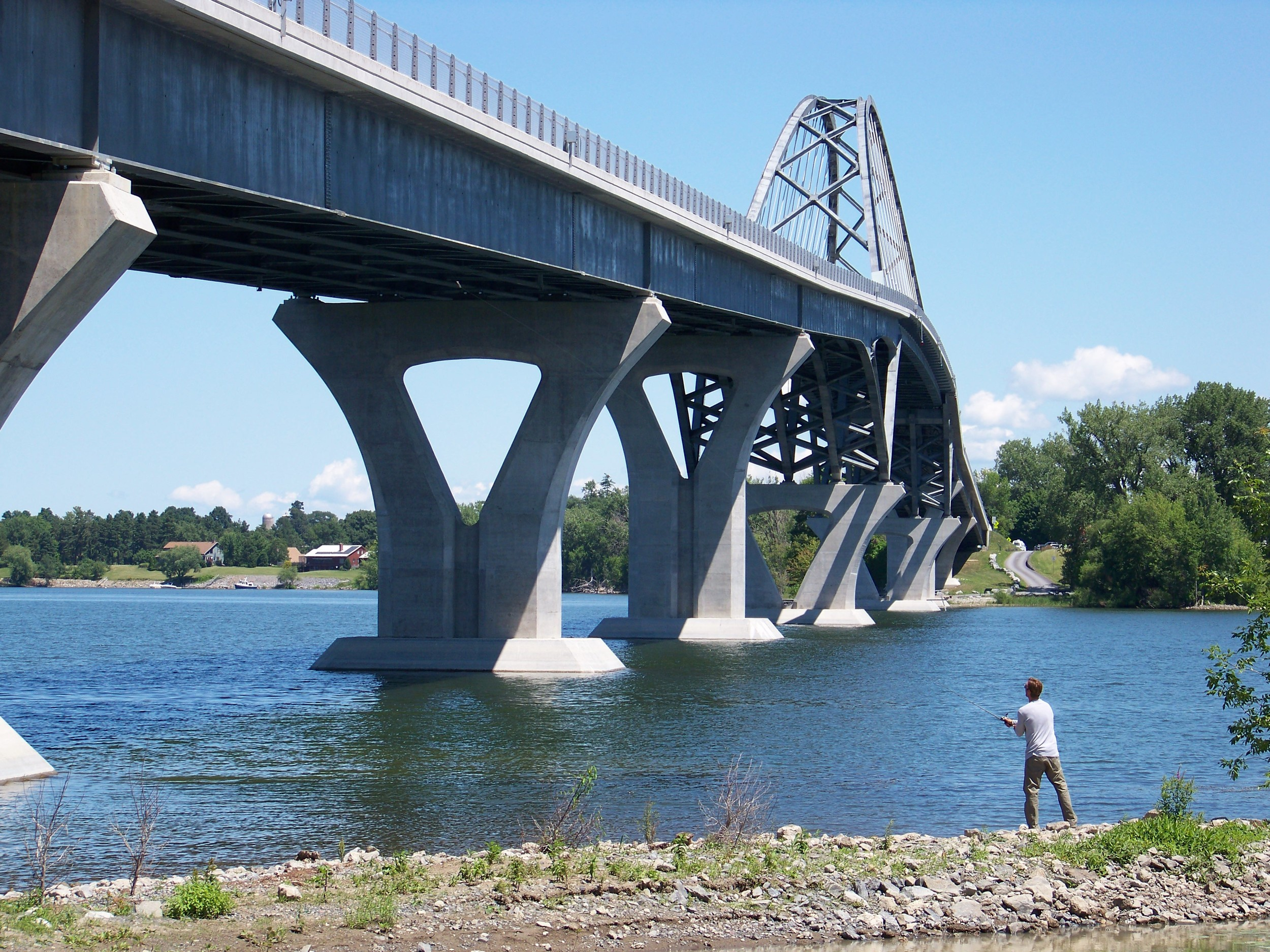 The Lake Champlain Bridge at the southern portion of the lake spanning from New York to Vermont. Troy is shore fishing in New York; the opposite shore is Vermont.