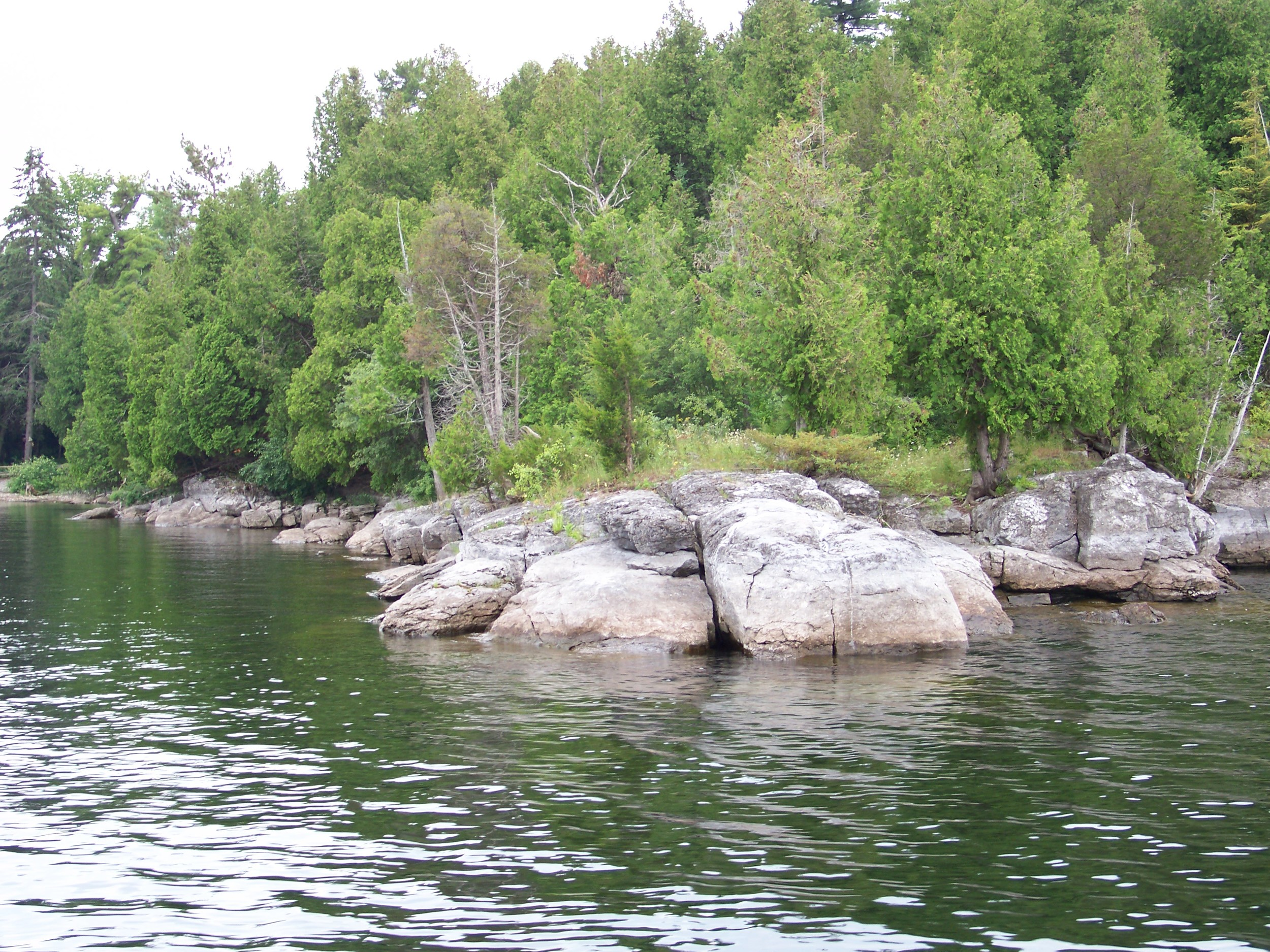 This rocky point on Valcour Island just south of Plattsburgh New York has a shallow bay to the left and steep bluff walls to the right.