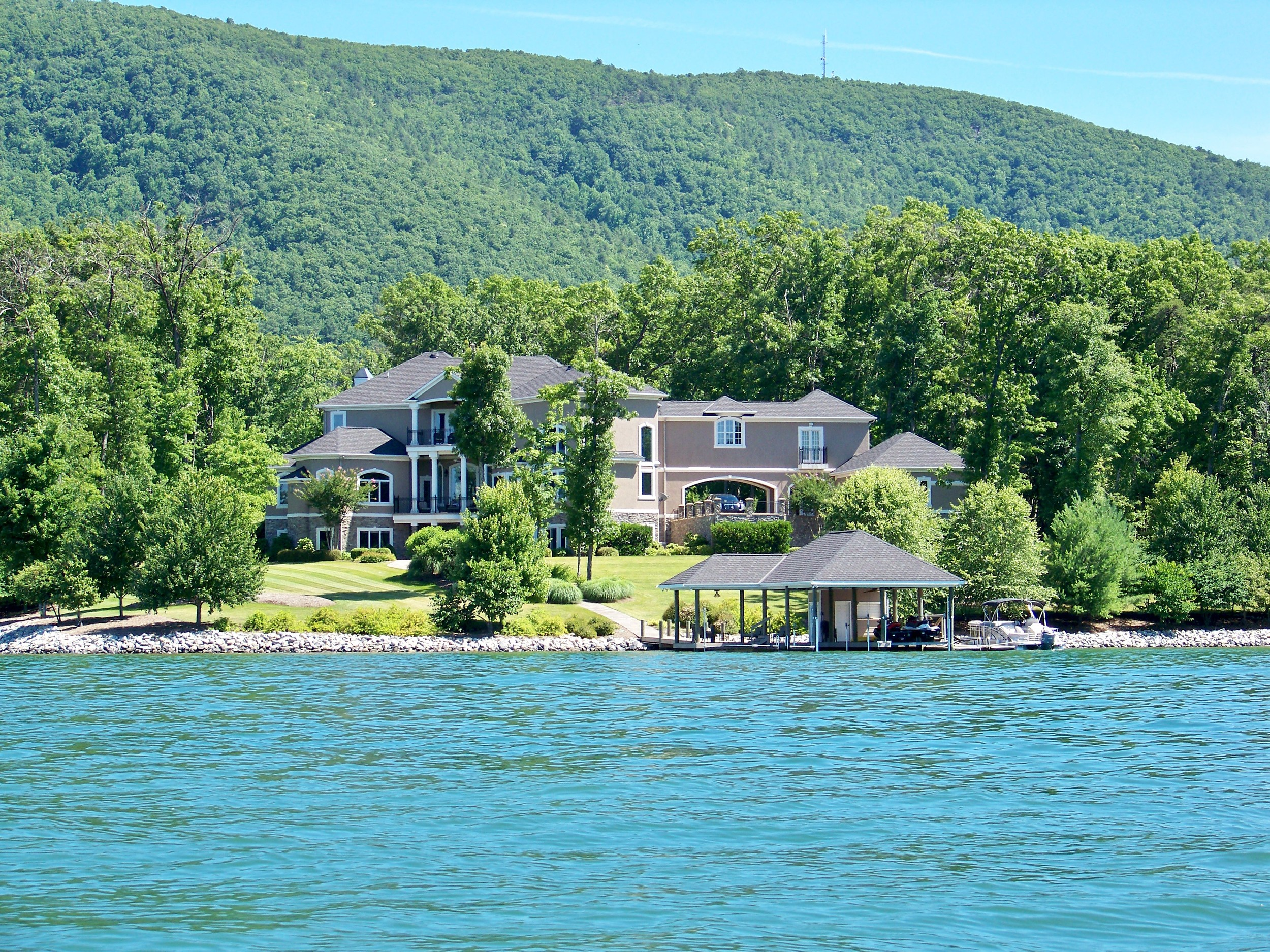 Homes and private docks nestled in green mountains can be found throughout the Smith Mountain landscape.