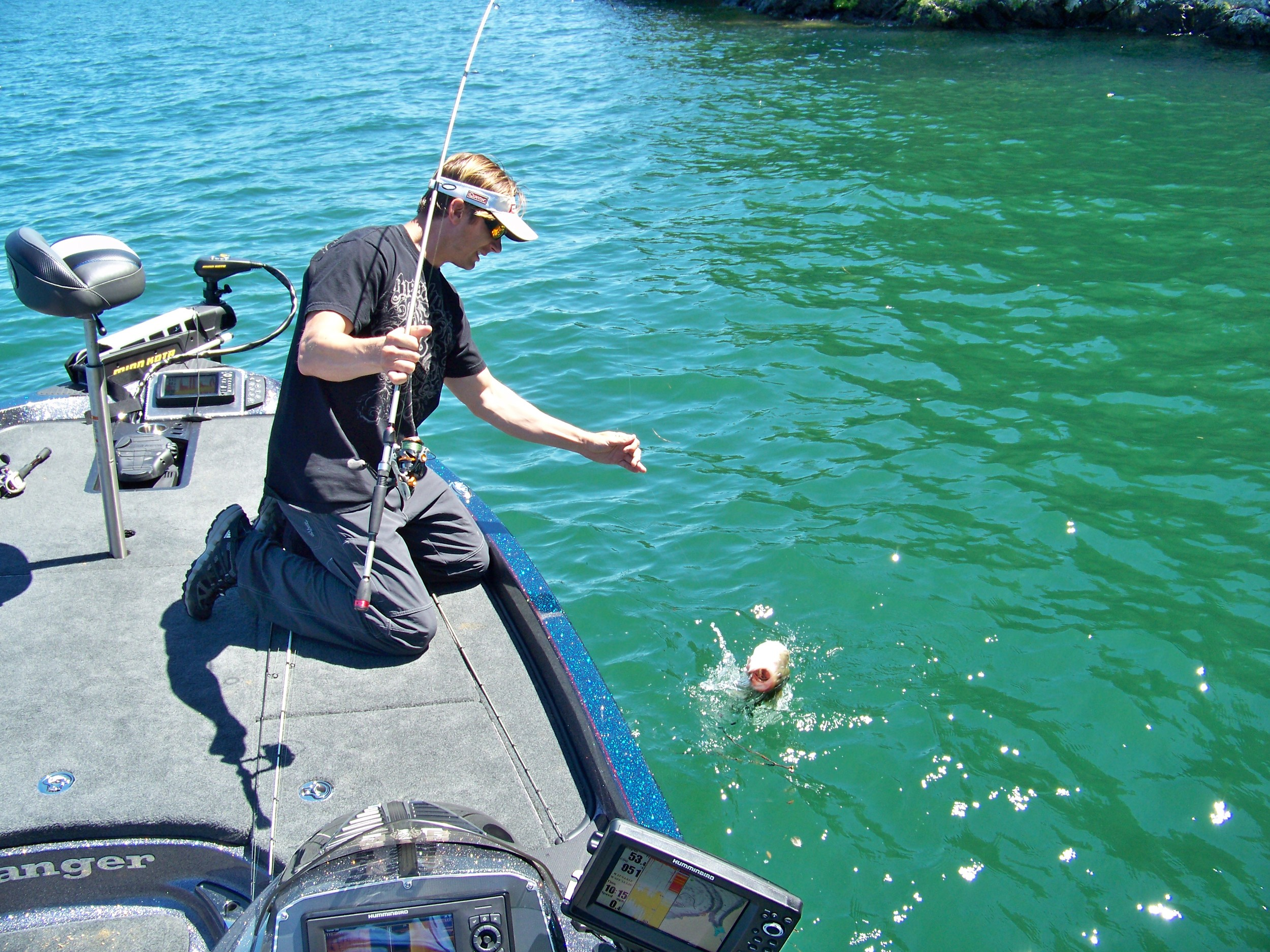 Troy proves that the location in the photo above was an excellent spot as he is about to boat a chunky largemouth.