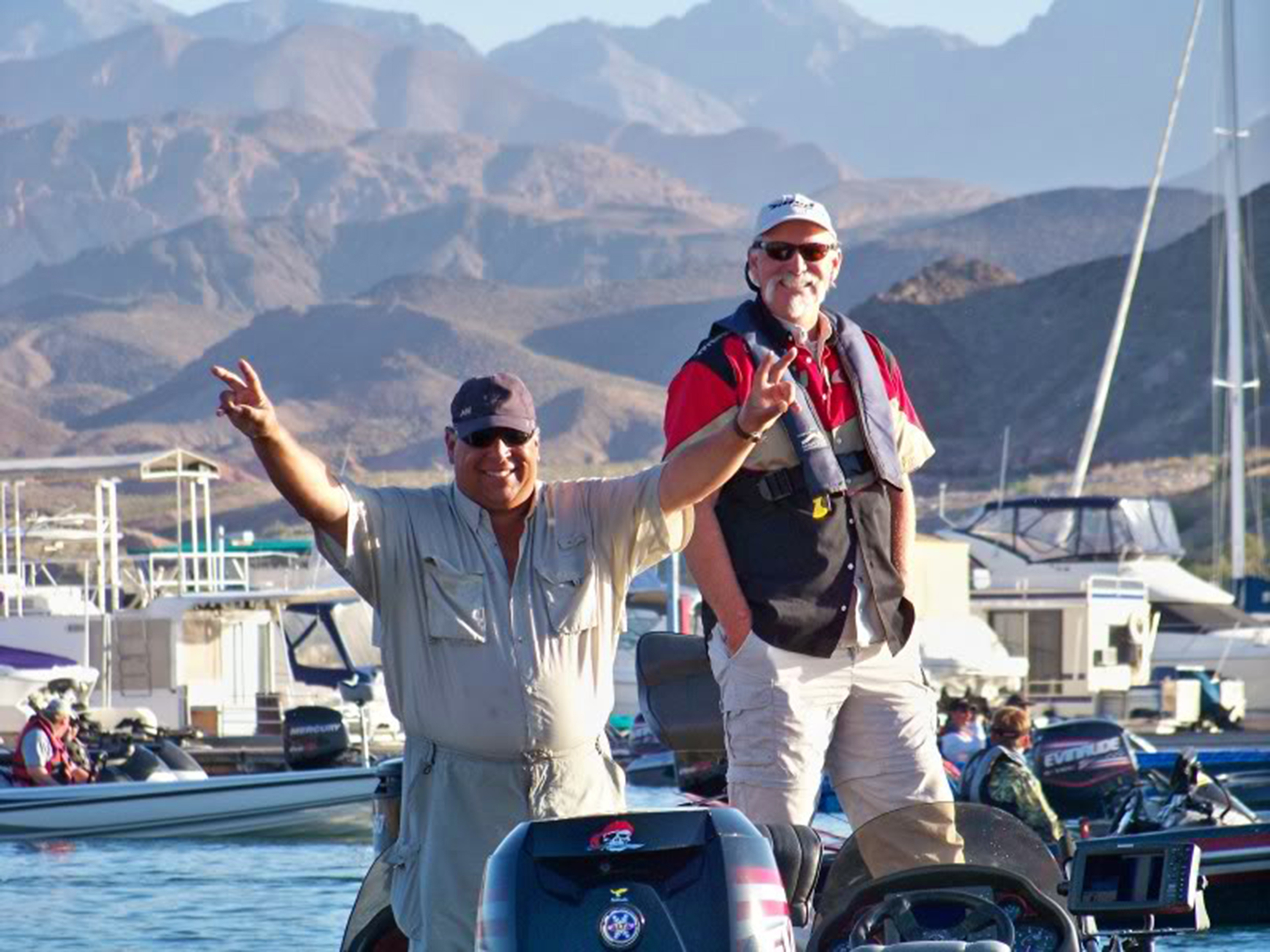 A winning smile and V for victory, Chris (closest to camera) doing what he does best at Lake Mead Nevada!