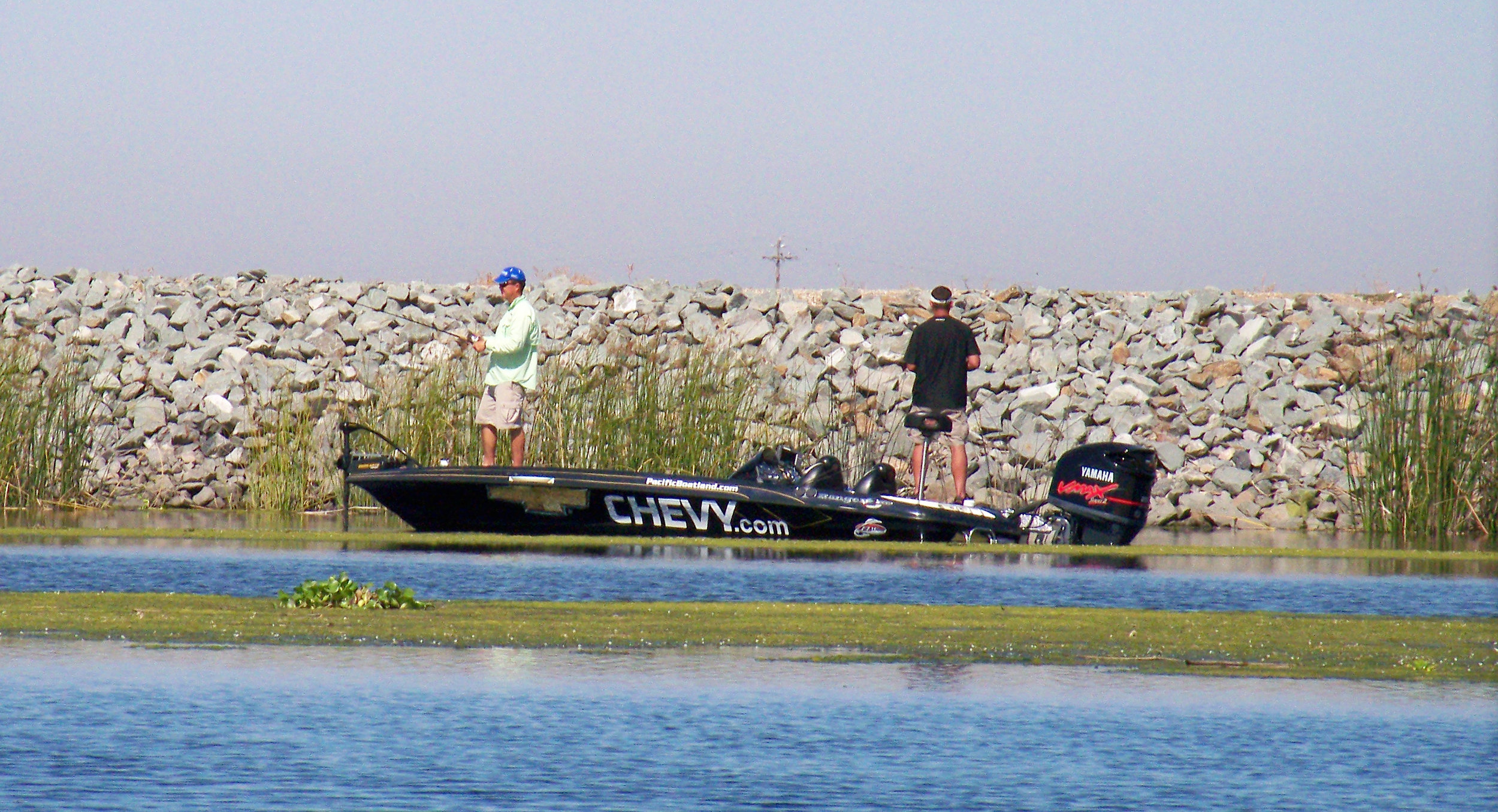Pro and Co-Angler fishing a levy bank at the California Delta.