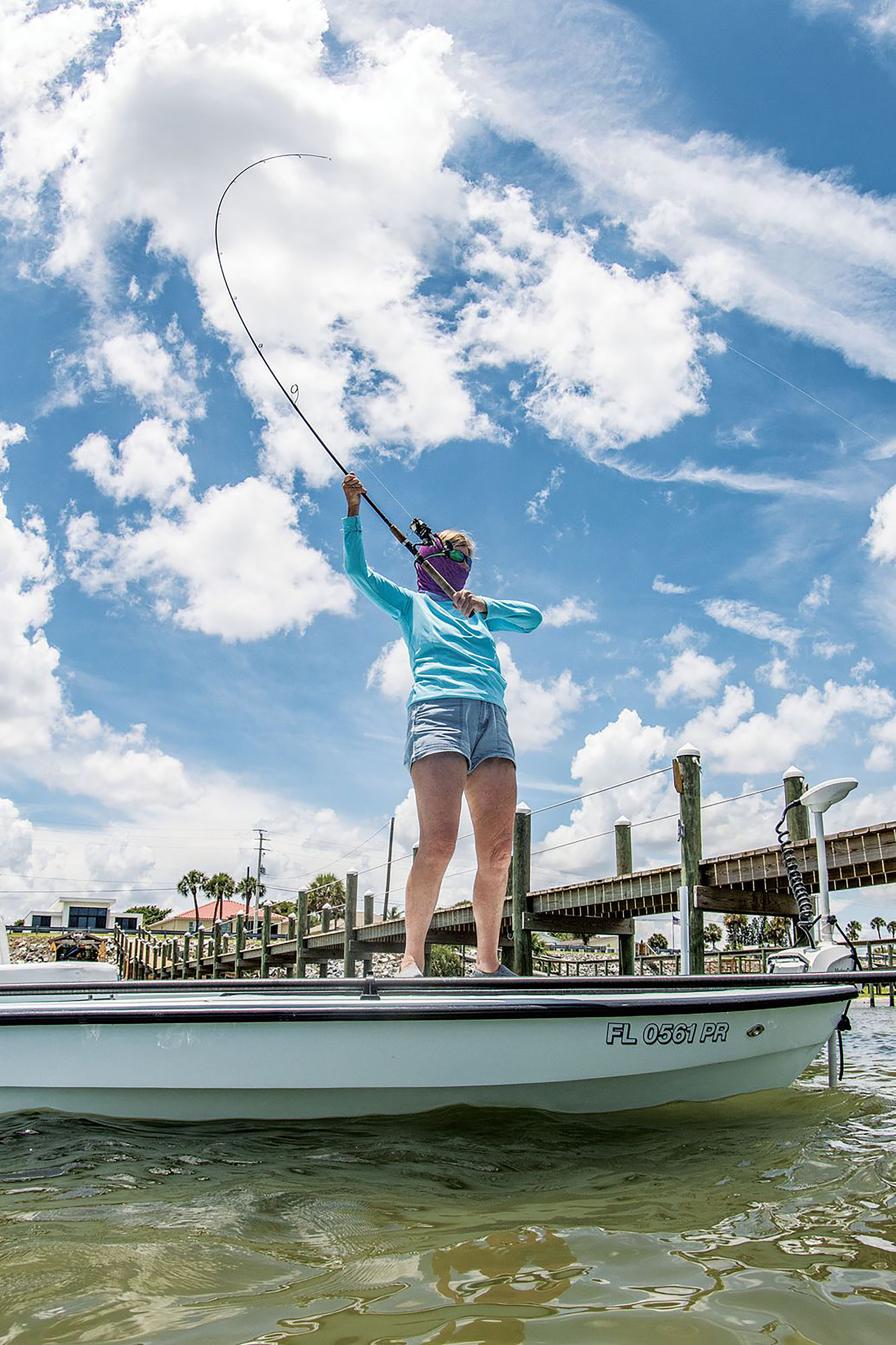 Curse of the high-sticked rod. Even experienced anglers can get a bit too enthusiastic when trying to coax in a big fish near the boat. This is particularly easy to do with fast-taper rods, which can easily snap in the stressed upper portion. In addition, this angler is making a second error that can lead to a broken rod by holding her hand far up on the rod blank, above the upper grip, where it should be. This alters the load dynamics and places stresses on the rod for which it wasn't designed. Adrian E. Gray