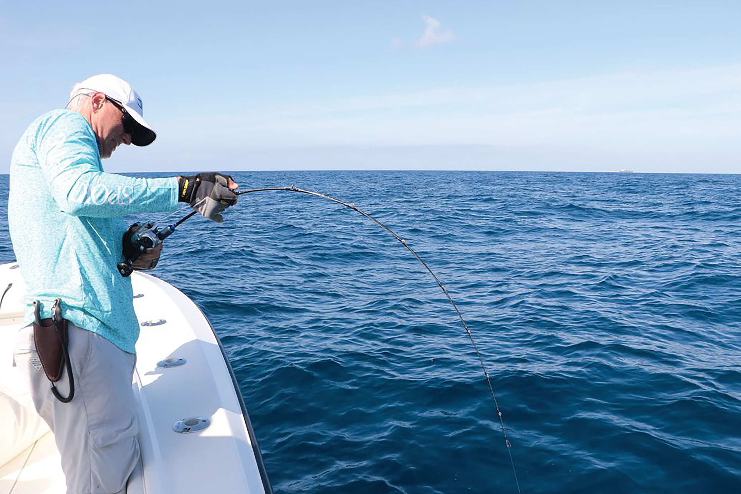 The current crop of slow-pitch jigging rods have a very slow, even taper and bend from the tip to the reel, but can sustain an amazing amount of pressure, as seen in this angler-versus-amberjack battle. Better, though, to keep the leading hand on the short foregrip rather than the rod itself, though it's easy to do the latter.  Doug Olander / Sport Fishing