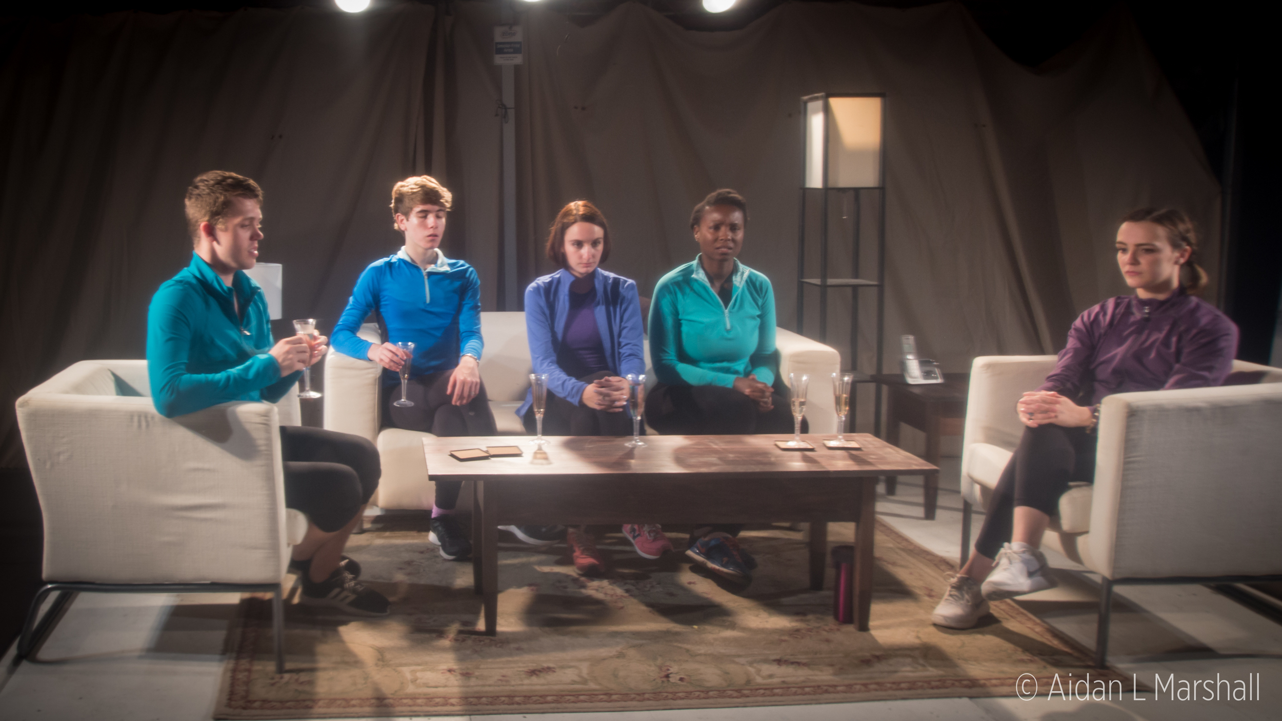 A group of five friends gather to celebrate an event.  Left to right: Three (Michael Palmer), Five (Austin Spero), One (Rachel Ravel), Two (Eunice Akinola), & Four (Anique Mercier)  Photo courtesy of Aidan L. Marshall.