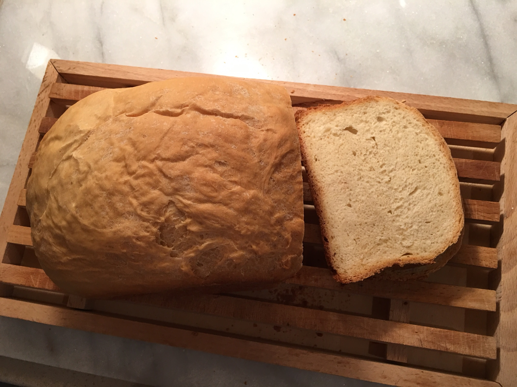 A 1½-lb loaf made in my bread machine. These days I prefer the smaller loaf (reduced from 2 lbs) because I find the size more ideal for toast and sandwiches. The French breadboard, a gift from my mother-in-law after a vacation in Vaucluse, is very handy for catching the crumbs when you slice.