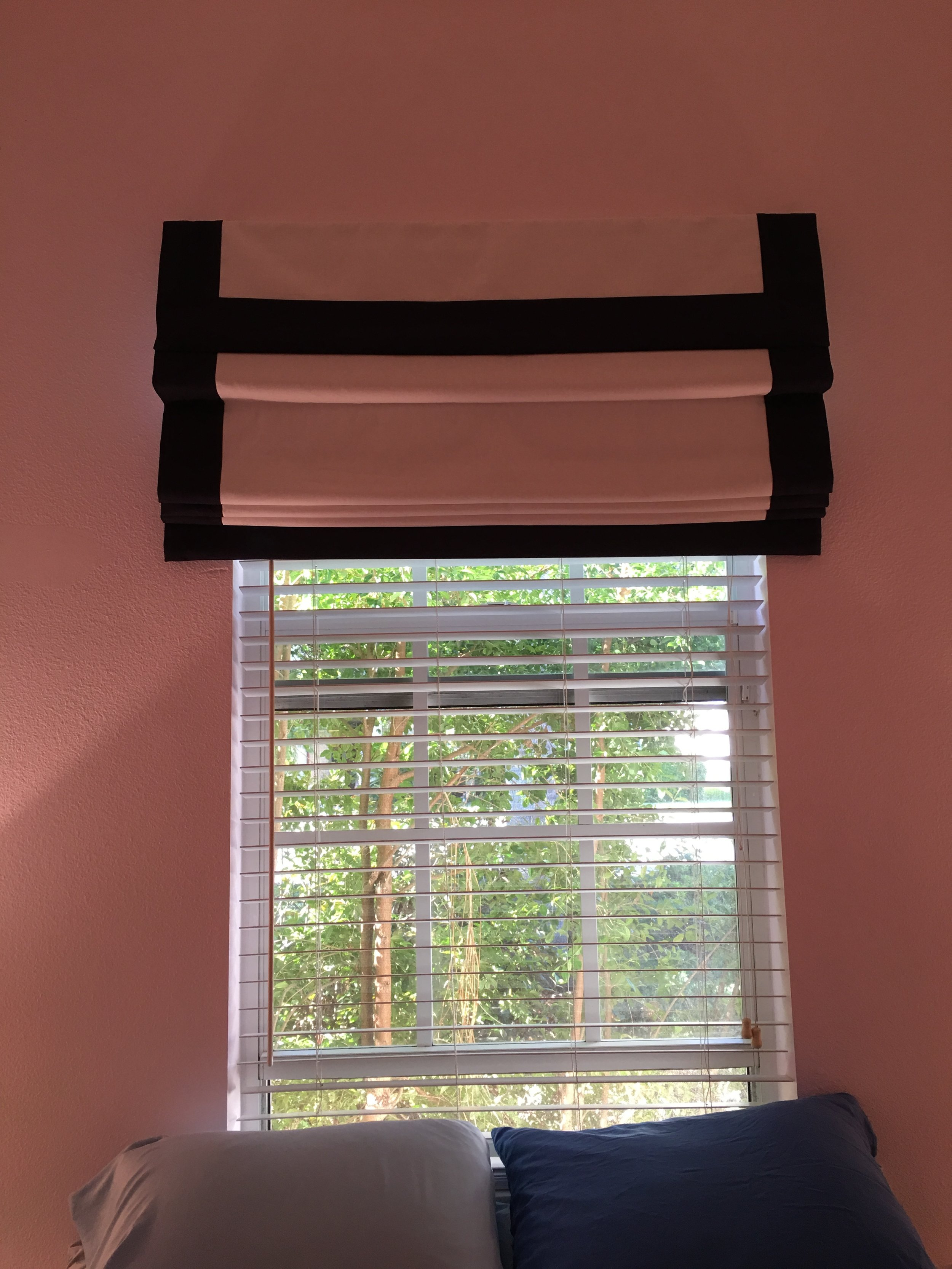 For a softer look, pull the blind down a little so more fabric shows. This one has a 'built-in' valance bordered by a broad navy stripe.