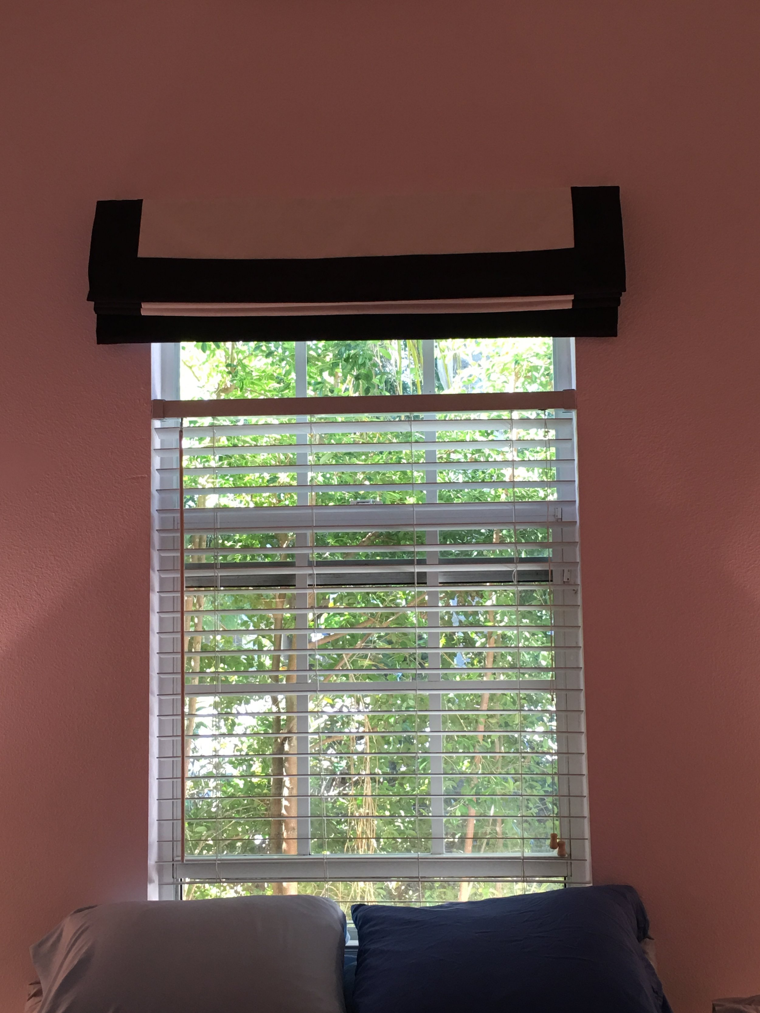 Roman blind fully retracted, with Venetian blind beneath.