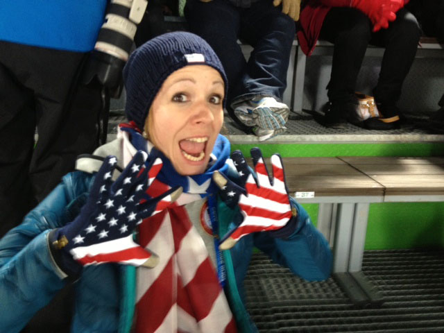 Valerie Tschui, WSJ-USA physical therapist, cheers during competition time.