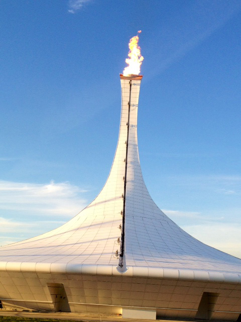 The Olympic flame at the Coastal Cluster in the Olympic Village.