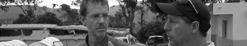 Matthew Jelacic and Tom Bowen survey a site in Leogane, Haiti.